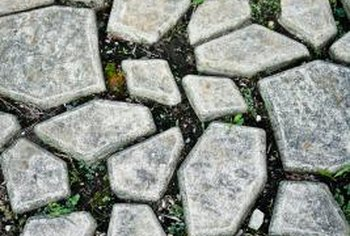 Irregular stepping stone shapes fit together like puzzle pieces to create an informal pathway.
