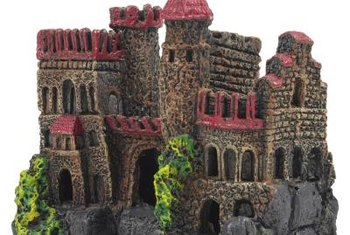 A large castle complements a fantasy-themed aquarium.