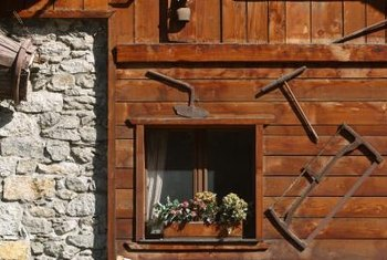 Old tools create visual interest to the exterior of a home.