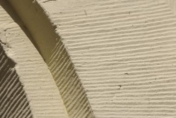 You can mimic a ridged stucco finish by using a comb.