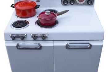 Resurfacing an old stove can offer a retro look for a new kitchen.