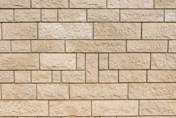 Block walls need special treatment before you can install vinyl siding.