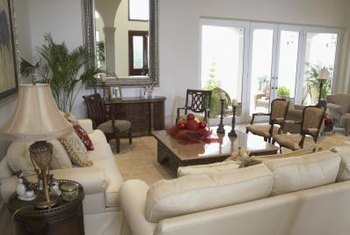 Light-colored sofas and chairs help brighten a living room.
