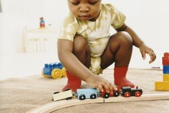 A dedicated train table keeps small toys off the floor.