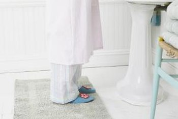 Keep bath mats clean and dry to prevent mold.