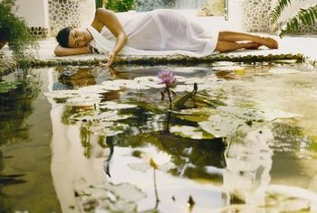A decorated lily pond becomes a place for relaxing meditation in your own yard.
