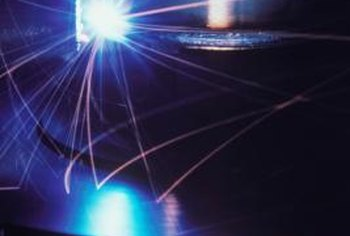 Some CNC machines use lasers for precision-cutting operations.