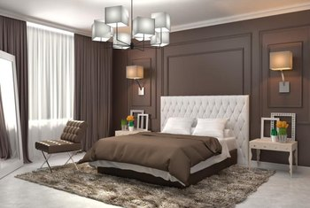 Create a luxurious earth-toned bedroom with champagne and chocolate colored linens.