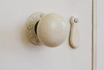 Install porcelain doorknobs on the correctly sized spindle.