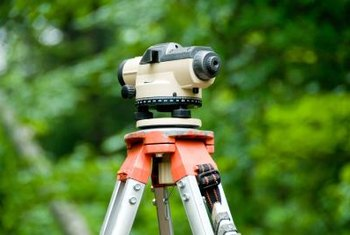 Surveyors determine the exact boundaries of your lot.