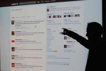 The main Twitter interface features tweets, followers and search functions.