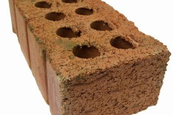 Loose bricks can support low garden beds.