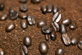 Don't throw away those coffee grounds -- use them as a garden booster.