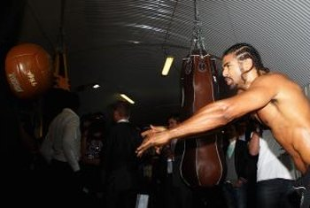 Heavyweight contender David Haye tosses the medicine ball to add core strength.