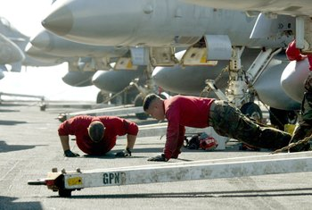 The Navy has its own way of performing pushups.