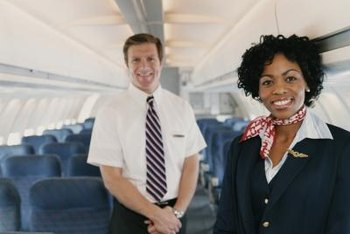 Flight attendants are trained to ensure the safety of passengers.
