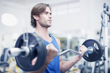 Standing barbell curls blast your biceps for bigger arms.
