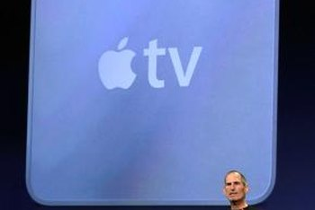 Apple TV integrates wireless access to entertainment content into a small-footprint set-top box.