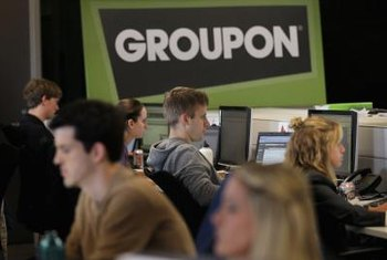 Groupon representative work with merchants to create successful campaigns.