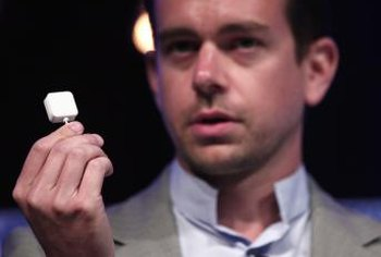 Card-readers like Square Register are inserted into a smarthphone's headphone jack.
