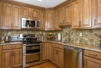 The warmth of honey spice cabinetry allows a variety of backdrop wall colors.