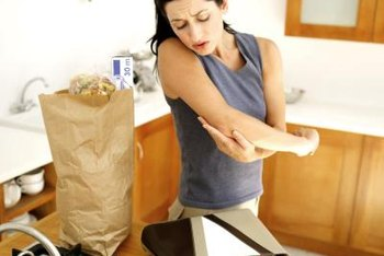 Carrying groceries is difficult with elbow arthritis.