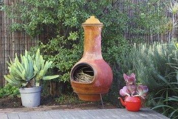 Add cultural flair to a Mexican themed patio with a rustic, wood burning chiminea.