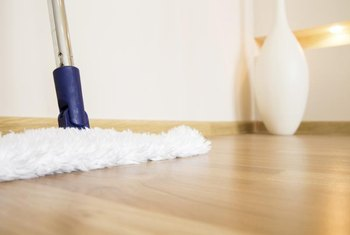 Frequent vacuuming and dry-mopping are the best ways to clean hardwood floors.