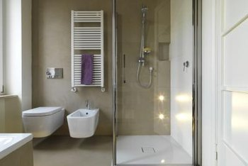 Metal frames encase glass shower doors.