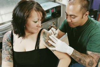 Tattoo artists design and apply tattoos.
