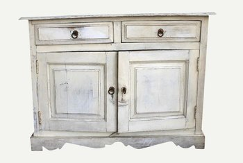 You can distress white furniture with hard objects, sandpaper and glaze.