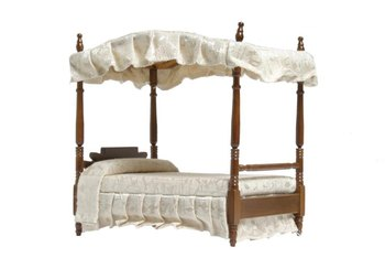 Arched canopy beds coordinate with ruffled canopy valances.