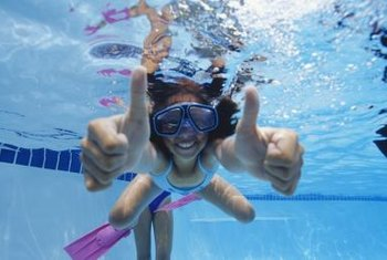 Fins build leg strength in young swimmers.