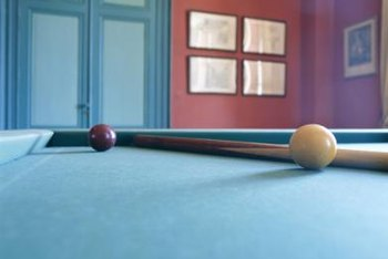 Recessed lighting works well over a pool table, where you don't want wires or fixtures to get in the way.