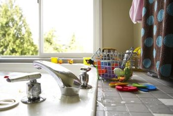 Remove and replace old countertop tile as you remodel your kitchen.