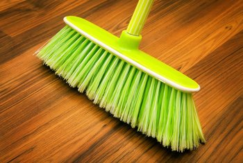 Use a soft-bristle broom to sweep your hardwood floors.