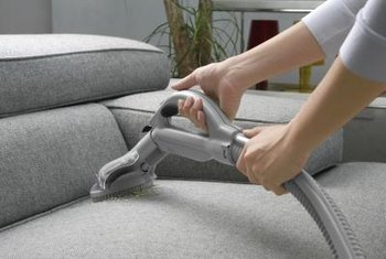 Vacuum upholstered furniture frequently to keep it clean.