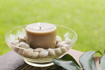 Use a candle flame in a secure holder to heat seal your fabric.