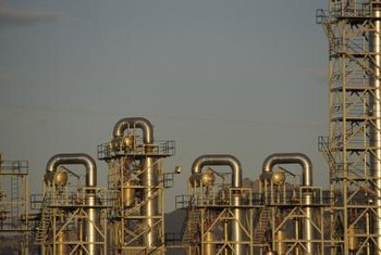 Pipe fitters often work in oil refineries and other sectors of heavy industry.