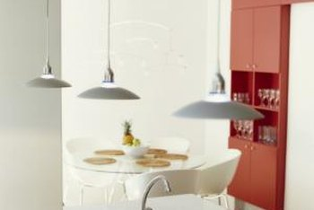 Pairing bright orange paint on the cabinets or walls with white creates a striking modern look for your kitchen.