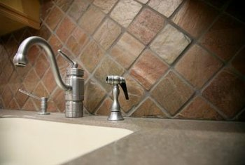 A kitchen tile backsplash is easy to install onto standard wall surfaces.