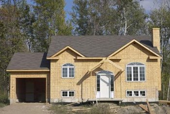 In new construction, windows are installed before vapor barriers, siding and trim.