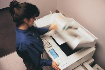 Enlarge documents for presentations or conferences using your copier.