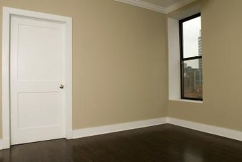 A pocket door helps solve space problems in a small room.