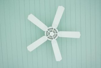 Painting your ceiling fan a neutral color such as white can help it blend with the rest of your bedroom decor.