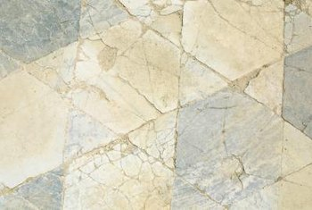 Porous tiles, such as slate, may be damaged by excess grout.