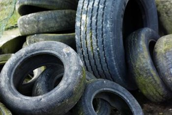 Paint the tires to make them more attractive in the garden.