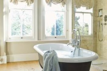 A dark-colored tub against light floors provides striking contrast.