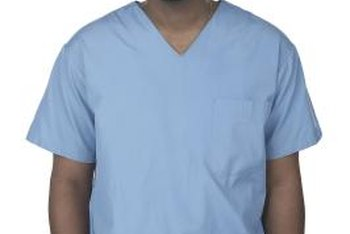 Scrub nurses help surgeons during eye surgery.