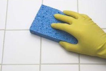 Ordinary household chemicals provide a safe and thrifty option for cleaning your bathroom tiles.
